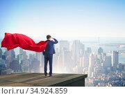 Super hero businessman on top of building ready for challenge. Стоковое фото, фотограф Elnur / Фотобанк Лори