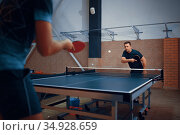 Two men play table tennis, ping pong players. Стоковое фото, фотограф Tryapitsyn Sergiy / Фотобанк Лори