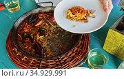 Spainsh dish seafood paella with rice, shrimps and mussels. Стоковое видео, видеограф Яков Филимонов / Фотобанк Лори