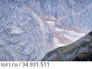 Cold alpine landscape with a glacier hidden between the spurs of the mountain. Стоковое фото, фотограф Евгений Харитонов / Фотобанк Лори