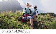 Tired senior hiker woman sitting on grass while hiking in the mountains. trekking. Стоковое видео, агентство Wavebreak Media / Фотобанк Лори
