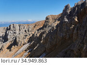 Glaciers survived until the end of summer in the shade of rocks on the north side of the Oshten mountain peak in the Caucasus. Стоковое фото, фотограф Евгений Харитонов / Фотобанк Лори