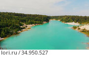 Landscape of a light blue lake surrounded by forest and sand mounds. Стоковое видео, видеограф Константин Шишкин / Фотобанк Лори