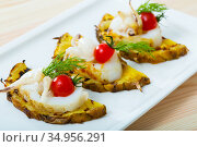 Grilled sepia and pineapple with cherry tomatoes and sweet-sour sauce chile. Стоковое фото, фотограф Яков Филимонов / Фотобанк Лори