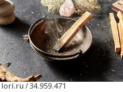 palo santo stick in cup and staff for magic ritual. Стоковое фото, фотограф Syda Productions / Фотобанк Лори