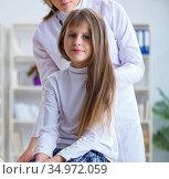 Female doctor pediatrician checking girl. Стоковое фото, фотограф Elnur / Фотобанк Лори