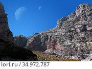 Fantastic alien landscape with rocks and two moons in the sky. Стоковое фото, фотограф Евгений Харитонов / Фотобанк Лори