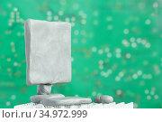 Computer monitor from plasticine on green background. Selective focus on screen. PC presentation. Handmade clay. Стоковое фото, фотограф Dmitry Domashenko / Фотобанк Лори