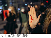 Warsaw, Poland - October 26, 2020: Participan of street blockade ... Редакционное фото, фотограф Konrad Zelazowski / age Fotostock / Фотобанк Лори