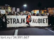 Warsaw, Poland - October 26, 2020: Women's strike banner during massive... Редакционное фото, фотограф Konrad Zelazowski / age Fotostock / Фотобанк Лори