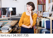 Thoughtful woman in fabric shop. Стоковое фото, фотограф Яков Филимонов / Фотобанк Лори