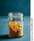 Garam masala in glass jar. Стоковое фото, фотограф Ольга Сергеева / Фотобанк Лори