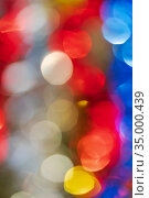 Defocused glowing lights, colorful abstract blurry bokeh background, vivid motion blur texture. Out of focus shining lens flare photo effect. Стоковое фото, фотограф А. А. Пирагис / Фотобанк Лори