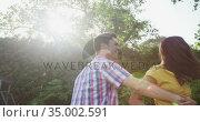 Happy caucasian couple in garden. Стоковое видео, агентство Wavebreak Media / Фотобанк Лори