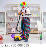 Funny clown doing cleaning at home. Стоковое фото, фотограф Elnur / Фотобанк Лори