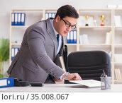 Businessman in industrial espionage concept. Стоковое фото, фотограф Elnur / Фотобанк Лори