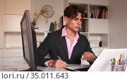 positive male manager working with docs in white room. Стоковое видео, видеограф Яков Филимонов / Фотобанк Лори