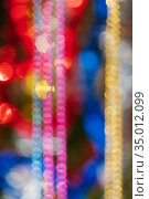Out of focus colorful abstract blurry bokeh background of balls, tinsel and beads. Shining lens flare photo effect. Стоковое фото, фотограф А. А. Пирагис / Фотобанк Лори