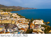 Aerial view of Nerja city by Mediterranean coast, Spain. Стоковое фото, фотограф Яков Филимонов / Фотобанк Лори