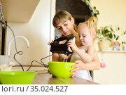 Girl with mom cook pie together. Стоковое фото, фотограф Арестов Андрей Павлович / Фотобанк Лори