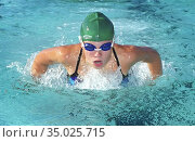 High school swimming meet includes breast stroke competition between... (2004 год). Редакционное фото, фотограф Dennis MacDonald / age Fotostock / Фотобанк Лори