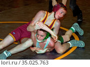 Contestants wrestle each other during middle school wrestling match. (2004 год). Редакционное фото, фотограф Dennis MacDonald / age Fotostock / Фотобанк Лори