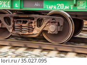 wheelset of a railway car rushes along the rails with great speed blur. Стоковое фото, фотограф Акиньшин Владимир / Фотобанк Лори
