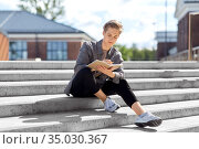 young man with notebook or sketchbook in city. Стоковое фото, фотограф Syda Productions / Фотобанк Лори
