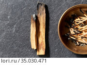 palo santo sticks and cup with burnt matches. Стоковое фото, фотограф Syda Productions / Фотобанк Лори