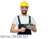 happy male worker or builder in helmet with drill. Стоковое фото, фотограф Syda Productions / Фотобанк Лори