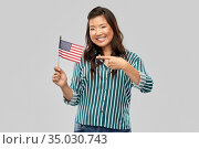 happy asian woman with flag of america. Стоковое фото, фотограф Syda Productions / Фотобанк Лори