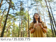 woman or witch performing magic ritual in forest. Стоковое фото, фотограф Syda Productions / Фотобанк Лори