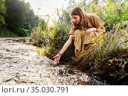 woman or witch performing magic ritual on river. Стоковое фото, фотограф Syda Productions / Фотобанк Лори