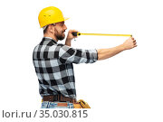 happy male worker or builder in helmet with ruler. Стоковое фото, фотограф Syda Productions / Фотобанк Лори