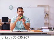 Young male student physicist studying molecular model at home. Стоковое фото, фотограф Elnur / Фотобанк Лори