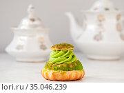 Pistachio cream cake and white tea set on the table. Стоковое фото, фотограф Катерина Белякина / Фотобанк Лори