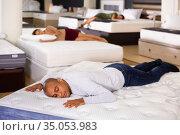 Positive man fell asleep on new mattress. Стоковое фото, фотограф Яков Филимонов / Фотобанк Лори