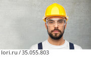 male worker or builder in helmet and overall. Стоковое фото, фотограф Syda Productions / Фотобанк Лори