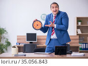 Young male employee playing darts in the office. Стоковое фото, фотограф Elnur / Фотобанк Лори