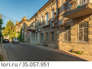 Revolution street in the old district of Yevpatoria, a narrow street with two-story buildings. Редакционное фото, фотограф Владимир Ушаров / Фотобанк Лори