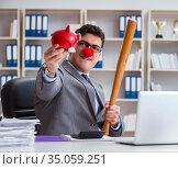 Clown businessman with a baseball bat and a piggy bank. Стоковое фото, фотограф Elnur / Фотобанк Лори