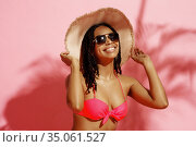 Young tanned woman in swimsuit, hat and sunglasses. Стоковое фото, фотограф Tryapitsyn Sergiy / Фотобанк Лори