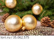 Christmas baubles and pine cones. Стоковое фото, фотограф Юлия Бабкина / Фотобанк Лори