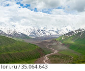 The peaks of Pik Kurumdy (6614m) at the border triangle of Kyrgyzstan... Стоковое фото, фотограф Martin Zwick / age Fotostock / Фотобанк Лори