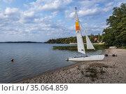 Catamaran over Narie Lake located in Ilawa Lakeland region, view ... Стоковое фото, фотограф Konrad Zelazowski / age Fotostock / Фотобанк Лори