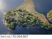 Island on Narie Lake located in Ilawa Lakeland region, view from ... Стоковое фото, фотограф Konrad Zelazowski / age Fotostock / Фотобанк Лори