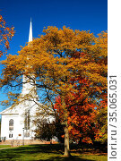 Fall colors surround a classic white clapboard church in Westfield... Стоковое фото, фотограф James Kirkikis / age Fotostock / Фотобанк Лори