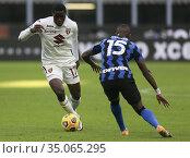 Wilfried Singo (Torino) Ashley Young (Inter) during the match ,Milan... Редакционное фото, фотограф Alberto Ramella / Sync / AGF/Alberto Ramella / Syn / age Fotostock / Фотобанк Лори