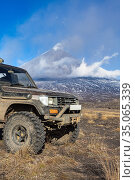 Modified Japanese SUV Toyota Land Cruiser Prado on mountain background eruption active volcano. Car lifted transmission for extreme terrain (2016 год). Редакционное фото, фотограф А. А. Пирагис / Фотобанк Лори