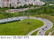Section of a bypass road with a bend and an overpass. Стоковое фото, фотограф Евгений Харитонов / Фотобанк Лори